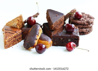 desserts cakes on a white background with berries and cream