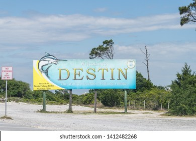 Destin, USA - April 24, 2018: Road sign, billboard with Welcome to Destin the World's luckiest fishing village in Florida Panhandle