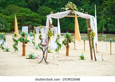 Destination beach wedding flower decor