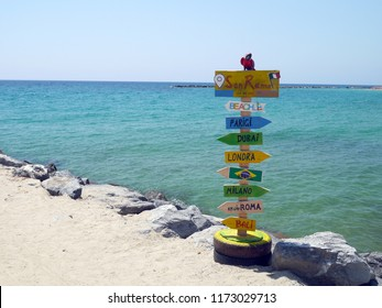 Destination sign against the sea in San Remo, Italy