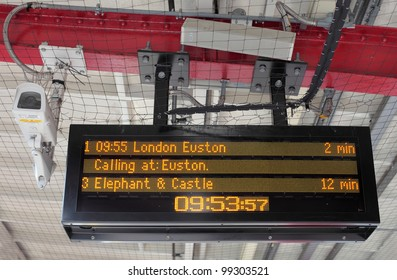 Destination and times of trains on London railway station platform electronic timetable