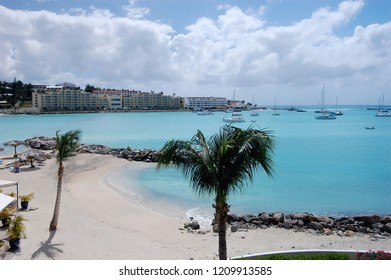 Destination Vacation Beach with Turquoise Water. Sailboats anchored in the lagoon.