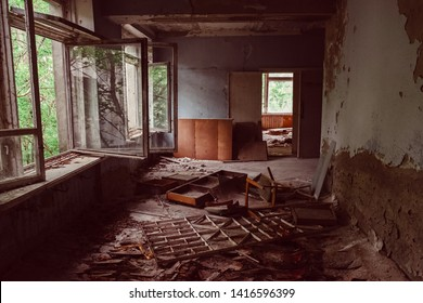 Destroyed abandoned ghost city Pripyat ruins after Chernobyl disaster. Chernobyl Nuclear Power Plant atomic reactor explosion. Exclusion zone, radiation risk, fallout lost town, apocalyptic building.