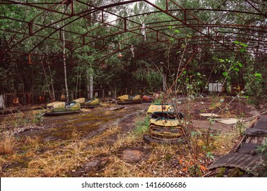 Destroyed abandoned ghost city Pripyat ruins after Chernobyl disaster. Old broken rusty metal radioactive cars, electric cars, amusement park. Exclusion zone, radiation risk, fallout lost town.