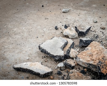 Destroyed asphalt road as a result of an earthquake with fractures of asphalt and soil