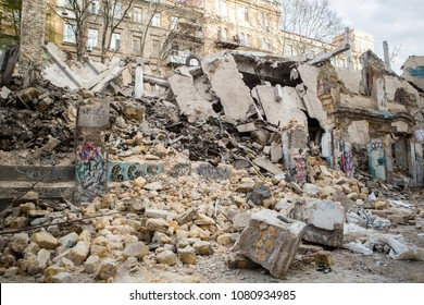 Destroyed building in city. Destroyed house. old house collapsed. Ruins of building. ruined building made of natural stone shell rock.