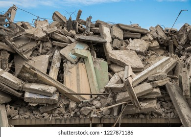 destroyed building - debris of Concrete and Metal from destroyed building