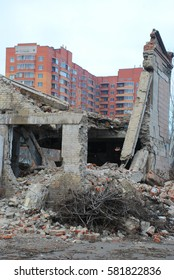 destroyed building on a background of a new high-rise buildings