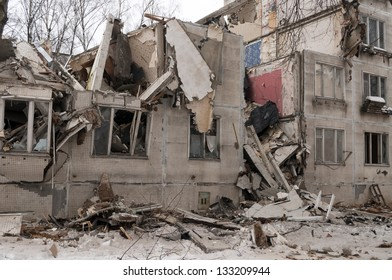 Destroyed building and pile of debris