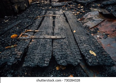 Destroyed by fire wooden door of completely burned house