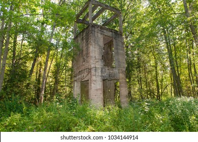 Destroyed by time water tower of reinforced concrete. Manor Zavetnoye. Novgorod Region, Russia