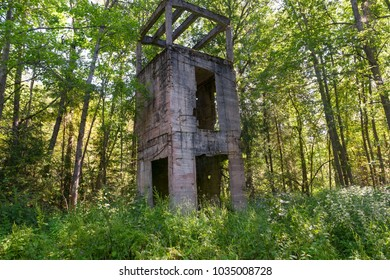 Destroyed by time water tower of reinforced concrete (1914). Manor Zavetnoye. Novgorod Region, Russia