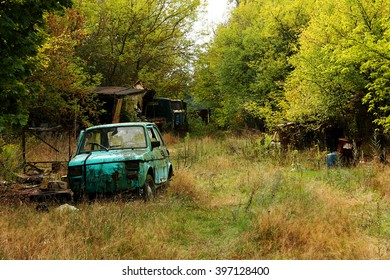 Destroyed car in an abandoned place