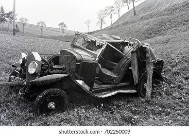 Destroyed car in meadow