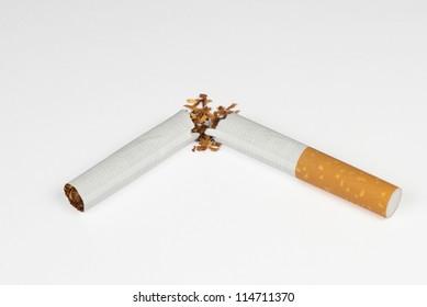 A destroyed cigarette, broken in half