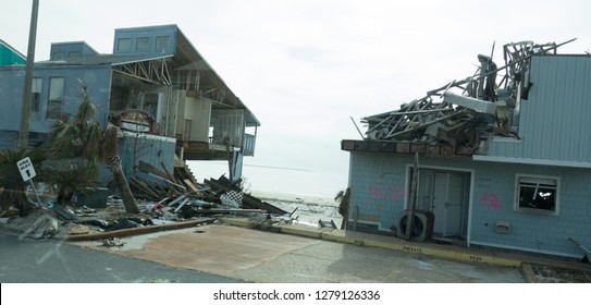 Destroyed Condo with walls torn off showing rooms inside house in the aftermath of hurricane Michael in Mexico beach Florida