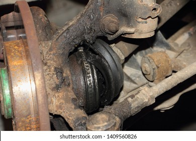 Destroyed CV joint duster, hub with brake disk and sterering rod - repair car suspension and gear drive