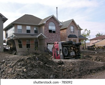 destroyed home and overturned SUV about 100 ft. from the 17th Street Canal levee breach that flooded New Orleans after Hurricane Katrina