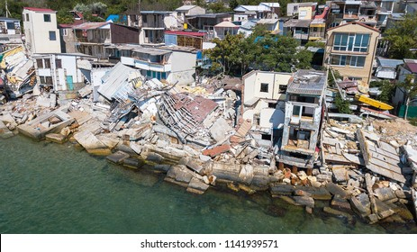 The destroyed house after the earthquake on the seashore.