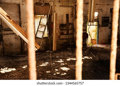 Destroyed office in abandoned building. Sun rays light up messy apocalyptique interior.