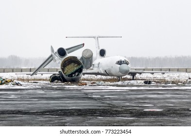 Destroyed old aircraft in the landfill at the airport in winter