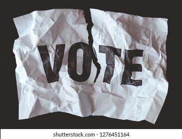 destroyed paper withword vote printed,crash of democracy concept