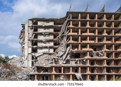 Destroyed residantial building of construction site .