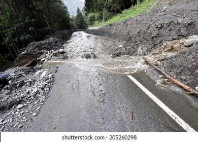 Destroyed rural road landslide damaged in powerful flood. Collapsed road on the mountain