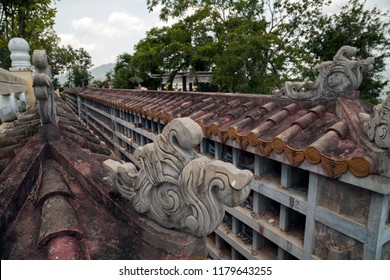 Destroyed traditional Buddhist columbarium in Vietnam. Beautiful decorated Asian cinerary cemetery with empty niches