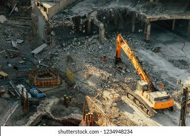 Destruction of the old road tunnel and the construction of a new junction. Excavator or crane at a construction site.