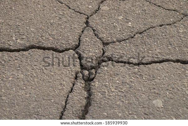 Destruction of the pavement as a result of natural effects.