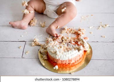 destruction of the pie for the first birthday.  cake smash