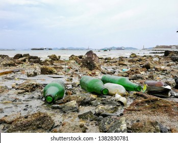 Destruction pollution environment garbage on the beach and the sea