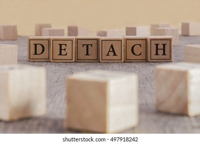 DETACH word written on building blocks concept