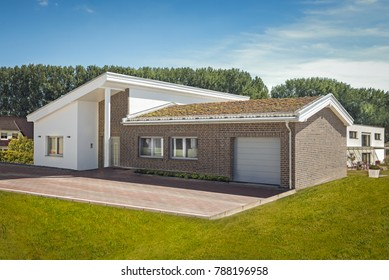 Detached house with garage and lawn