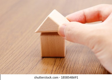 A detached house made of building blocks. The image of a mortgage or home or family.