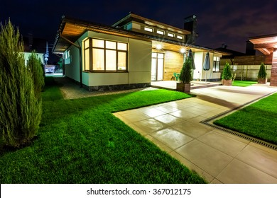 Detached house at night view from outside the rear courtyard.
