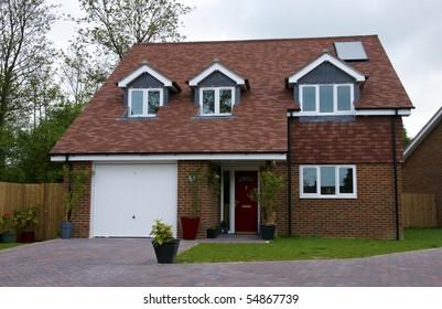 A detached house with an overcast sky
