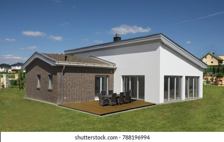 Detached house with terrace and lawn