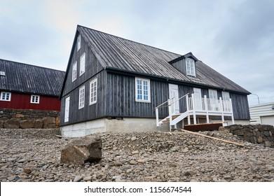 Detached modern icelandic/norvegian/scandinavian house exterior with ladder surrounded ground