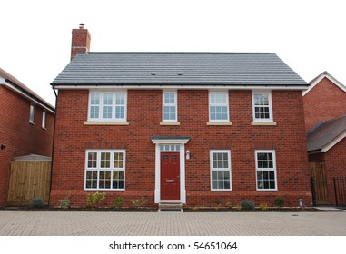 detached and typical british residential house with small entrance garden (isolated on white)