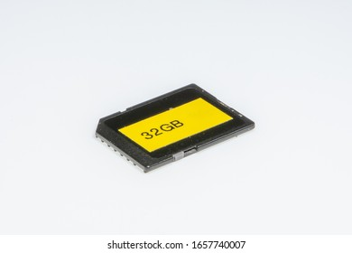 Detail of an 32 Gigabytes storage memory, on a white background