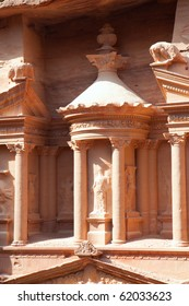 Detail of 3.5 m high urn in the middle of second level of Treasury (Al-Khazneh)  in ancient city of Petra in Jordan. It was carved out of a single rock. It is now an UNESCO World Heritage Site.