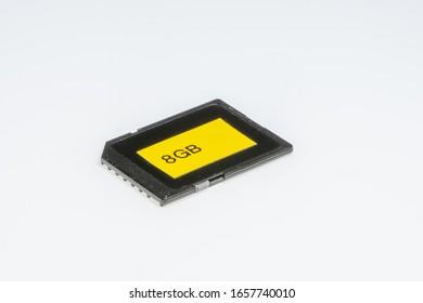 Detail of an 8 Gigabytes storage memory, on a white background