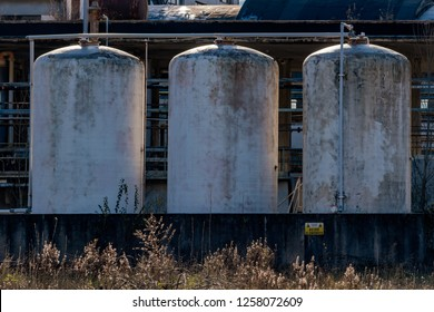 detail of abandoned factory chemical plant tanks
