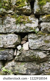 Detail of an abandoned stone building in a forest.  Old Stone Fort State Archaeological Park, Manchester, TN, USA.