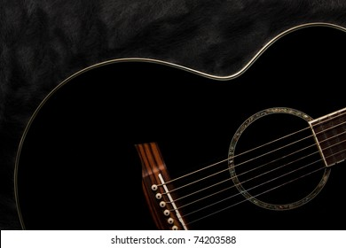 Detail of an acoustic black guitar