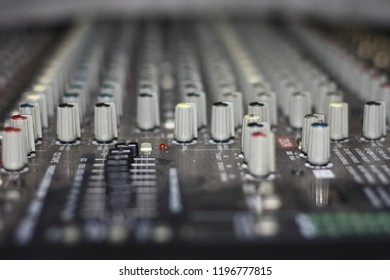 Detail with adjusting knobs on a professional audio mixer and music equipment for sound mixer control, electronic device,selective focus only on some point in image