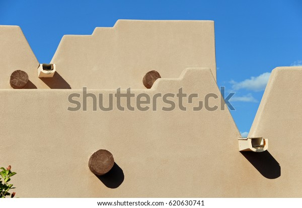 Detail of adobe house with blue sky