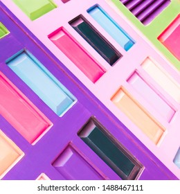 Detail of African door pattern. Abstract colorful background in fashion trendy bright pastels of 2019: Proton Purple, Plastic Pink and UFO Green, also pale baby blue, white and black. Selective focus.